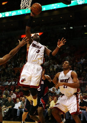 MIAMI - DECEMBER 12:  Dwyane Wade #3 of the Miami Heat scores against the Atlanta Hawks at American Airlines Arena on December 12, 2008 in Miami, Florida. NOTE TO USER: User expressly acknowledges and agrees that, by downloading and/or using this Photogra