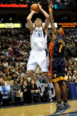 DALLAS - JANUARY Forward Dirk Nowitzki #41 of the Dallas Mavericks takes a shot against Stephen Jackson #1 of the Golden State Warriors on January 28, 2008 at American Airlines Center in Dallas, Texas. NOTE TO USER: User expressly acknowledges and agrees