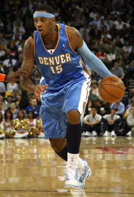 OAKLAND, CA - NOVEMBER 05:  Carmelo Anthony #15 of the Denver Nuggets drives against the Golden State Warriors during an NBA game on November 5, 2008 at Oracle Arena in Oakland, California. NOTE TO USER: User expressly acknowledges and agrees that, by dow