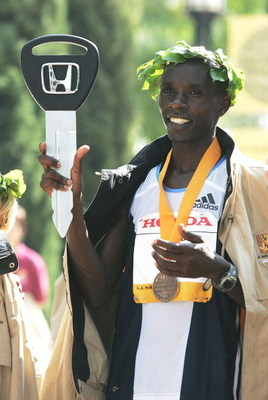 LOS ANGELES, CA - MARCH 6:  Mark Saina of Kenya holds up the ceremonial Honda key that was presented to him after finishing first in the men's division of the 20th anniversary of the Los Angeles Marathon on March 6, 2005 in Los Angeles, California. Saina