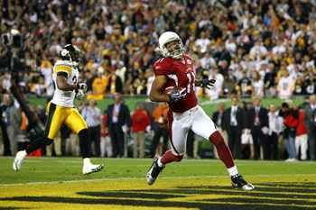 TAMPA, FL - FEBRUARY 01:  Larry Fitzgerald #11 of the Arizona Cardinals celebrates after scoring on a 64-yard touchdown reception in the fourth quarter against the Pittsburgh Steelers during Super Bowl XLIII on February 1, 2009 at Raymond James Stadium in