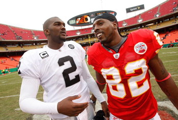 KANSAS CITY, MO - SEPTEMBER 14:  Former LSU teammates Dwayne Bowe #82 of the Kansas City Chiefs and JaMarcus Russell #2 of the Oakland Raiders share a word after their NFL game at Arrowhead Stadium on September 14, 2008 in Kansas City, Missouri. The Raide