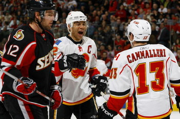 OTTAWA - MARCH 3:  Jarome Iginla #12 of the Calgary Flames celebrates his go-ahead goal with teammate Michael Cammalleri #13 while Mike Fisher #12 of the Ottawa Senators looks on on March 3, 2009 at the Scotiabank Place in Ottawa, Canada. (Photo by Philli