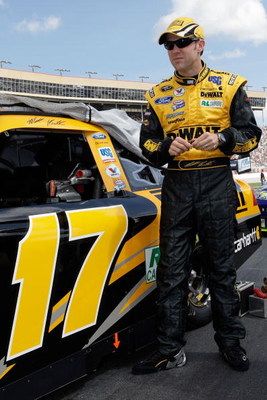 HAMPTON, GA - MARCH 08:  Matt Kenseth driver of the Dewalt Ford stands by his car before the start of the NASCAR Sprint Cup Series Kobalt Tools 500 at the Atlanta Motor Speedway on March 8, 2009 in Hampton, Georgia.  (Photo by John Harrelson/Getty Images)