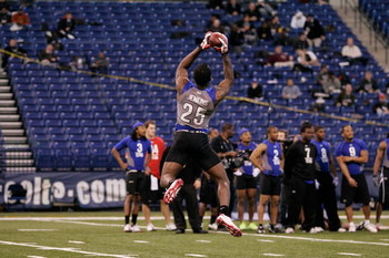 INDIANAPOLIS, IN - FEBRUARY 24:  Defensive back Malcolm Jenkins of Ohio State jumps in the air to catch the football during the NFL Scouting Combine at Lucas Oil Stadium on February 24, 2009 in Indianapolis, Indiana. (Photo by Scott Boehm/Getty Images)
