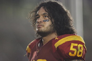 PASADENA, CA - DECEMBER 6:  Rey Maualuga #58 of the USC Trojans reflects after celebrating with the band and fans following the victory against the UCLA Bruins on December 6, 2008 at the Rose Bowl in Pasadena, California.  USC won 28-7.  (Photo by Jeff Go