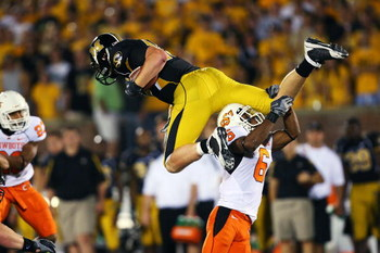 COLUMBIA, MO - OCTOBER 11:  Ricky Price #6 of the Oklahoma State Cowboys upends Chase Coffman #45 of the Missouri Tigers on October 11, 2008 at Memorial Stadium in Columbia, Missouri.  Oklahoma State won 28-23. (Photo by G. Newman Lowrance/Getty Images)