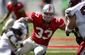 COLUMBUS, OH - SEPTEMBER 20:  James Laurinaitis #33 of the Ohio State Buckeyes keeps an eye on the runner during the third quarter while playing the Troy Trojans on September 20, 2008 at Ohio Stadium in Columbus, Ohio. Ohio State won the game 28-10.  (Pho