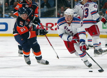 UNIONDALE, NY - MARCH 05:  Lauri Korpikoski #29 of the New York Rangers skates against Kyle Okposo #21 of the New York Islanders on March 5, 2009 at Nassau Coliseum in Uniondale, New York. The Rangers defeated the Islanders 4-2.  (Photo by Jim McIsaac/Get