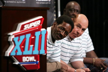 PHOENIX - FEBRUARY 01:  Former Miami Dolphins (L-R)  Eugene 'Mercury' Morris, Garo Yepremian, and Larry Little listen to a question during a press conference anouncing Reebok's new television campaign -dubbed 'Perfectville'- featuring members of the only