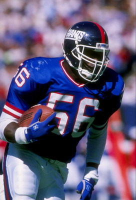 24 Sep 1989: Linebacker Lawrence Taylor of the New York Giants holds the ball during a game against the Phoenix Cardinals at Giants Stadium in the Meadowlands in East Rutherford, New Jersey. The Giants won the game 35-7.