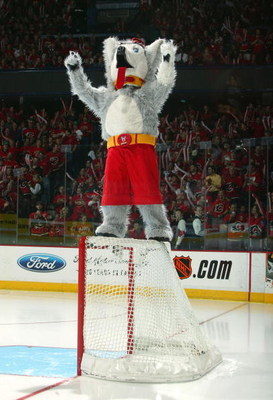 CALGARY, ALBERTA - MAY 16:  Mascot of the Calgary Flames, Harvey the Hound, pumps up the crowd before Game four of the 2004 NHL Western Conference Finals against the San Jose Sharks on May 16, 2004 at the Pengrowth Saddledome in Calgary, Alberta, Canda.