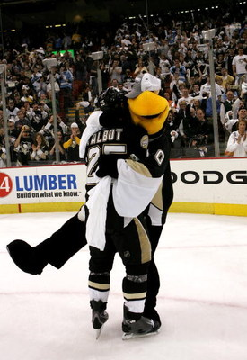 PITTSBURGH - MAY 18:  Maxime Talbot #25 of the Pittsburgh Penguins celebrates with mascot 'Iceburgh' after their team's 6-0 victory over the Philadelphia Flyers in game five of the Eastern Conference Finals of the 2008 NHL Stanley Cup Playoffs at Mellon A