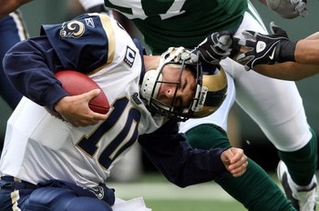 EAST RUTHERFORD, NJ - NOVEMBER 09:  Marc Bulger #10 of the St. Louis Rams is sacked against the New York Jets at Giants Stadium on November 9, 2008 in East Rutherford, New Jersey.  (Photo by Nick Laham/Getty Images)