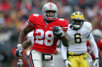 COLUMBUS, OH - NOVEMBER 22: Chris Wells #28 of the Ohio State Buckeyes runs for a touchdown during the Big Ten Conference game against the Michigan Wolverines at Ohio Stadium on November 22, 2008 in Columbus, Ohio.  (Photo by Andy Lyons/Getty Images)