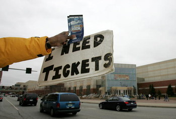 INDIANAPOLIS - APRIL 01: A ticket scalper holds out a pair of tickets along with a sign asking for tickets before the start of the Semifinal games of the NCAA Men's Final Four on April 1, 2006 at the RCA Dome in Indianapolis, Indiana. (Photo by Streeter L