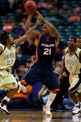 ATLANTA - MARCH 13: Rasheem Barrett #21 of the Auburn Tigers passes the ball over Jamie Graham #22 of the Vanderbilt Commodores during the SEC Basketball Tournament on March 13, 2008 at the Georgia Dome in Atlanta, Georgia.  The Commodores defeated the Ti