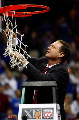 KANSAS CITY, MO - MARCH 16:  Head coach Bill Self of the Kansas Jayhawks cuts down the net after the Jayhawks defeated the Texas Longhorns to win the Big 12 Men's Basketball Tournament Finals on March 16, 2008 at the Sprint Center in Kansas City, Missouri