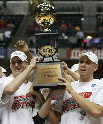 INDIANAPOLIS - MARCH 16:  (L-R) Brian Butch #32 and Greg Stiemsma #34 of the Wisconsin Badgers celebrate with the tournament championship trophy after their 61-48 win against the Illinois Fighting Illini during the Championship game of the Big Ten Men's B