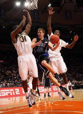 NEW YORK - NOVEMBER 21:  Jon Scheyer #30 of the Duke Blue Devils goes to the basket between DeShawn Sims #34 and Manny Harris #3 of the Michigan Wolverines on November 21, 2008 at Madison Square Garden in New York City.  (Photo by Nick Laham/Getty Images)
