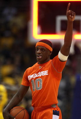 MILWAUKEE - MARCH 07: Jonny Flynn #10 of the Syracuse Orange celebrates a win over the Marquette Golden Eagles on March 7, 2009 at the Bradley Center in Milwaukee, Wisconsin. Syracuse defeated Marquette 86-79 in overtime. (Photo by Jonathan Daniel/Getty I