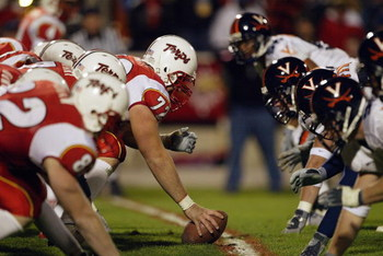 COLLEGE PARK, MD - NOVEMBER 13:  Center Kyle Schmitt #72 of the Maryland Terrapins gets ready to hike the football during the game against the Virginia Cavaliers on November 13, 2003 at Byrd Stadium in College Park, Maryland. The Terps defeated the Cavs 2