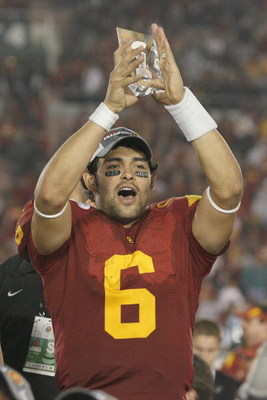 PASADENA, CA - JANUARY 1:  Mark Sanchez #6 of the USC Trojans rejoices as he holds te Offensive Player of the Game Trophy after the game against the Penn State Nittany Lions on January 1, 2009 at the Rose Bowl in Pasadena, California.  USC won 38-24.  (Ph