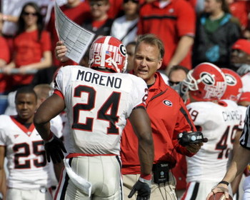 ORLANDO, FL - JANUARY 1: Running back Knowshon Moreno #24 of the University of Georgia talks with coach Mark Richt against the Michigan State Spartans during the 2009 Capital One Bowl at the Citrus Bowl on January 1, 2009 in Orlando, Florida.  (Photo by A