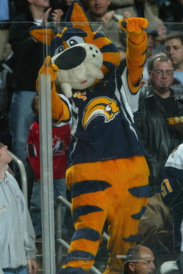 BUFFALO, NY - NOVEMBER 23:  The Buffalo Sabres mascot Sabretooth climbs on the glass during the game against the Montreal Canadiens at HSBC Arena on November 23, 2007 in Buffalo, New York. (Photo by Dave Sandford/Getty Images)