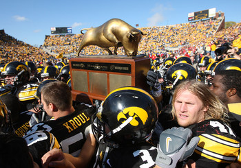 18 OCTOBER 2008: Iowa defensive lineman Mitch King (47) and his fellow players hold the Heartland Trophy after an NCAA college football game against Wisconsin, at Kinnick Stadium in Iowa City, Iowa on Saturday Oct. 18, 2008. Iowa won 38-16.