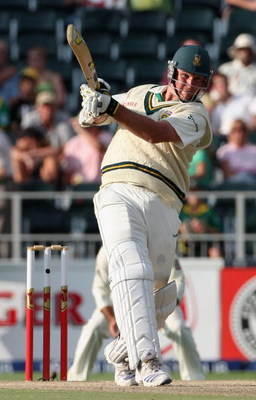 JOHANNESBURG, SOUTH AFRICA - MARCH 01:  Graeme Smith of South Africa skies a ball to be caught during day four of the First Test between South Africa and Australia played at the Wanderers on March 1, 2009 in Johannesburg, South Africa.  (Photo by Hamish B