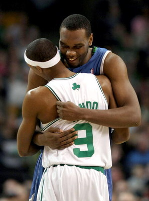 BOSTON - FEBRUARY 01:  Al Jefferson #25 of Minnesota Timberwolves and  Rajon Rondo #9 of the Boston Celtics greet each other before the game on February 1, 2009 at TD Banknorth Garden in Boston, Massachusetts. NOTE TO USER: User expressly acknowledges and