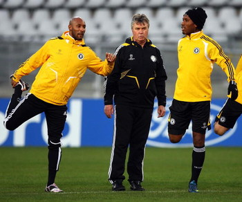 TORINO, ITALY - MARCH 09:  Chelsea Manager Guus Hiddink looks on as Nicolas Anelka (L) and Didier Drogba (R) warm up during training at Stadio Olimpico di Torino on March 9, 2009 in Turin, Italy. Juventus and Chelsea will play the UEFA Champions League fi