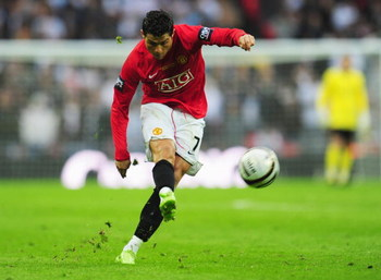 LONDON - MARCH 01:  Cristiano Ronaldo of Manchester United shoots during the Carling Cup Final match between Manchester United and Tottenham Hotspur at Wembley Stadium on March 1, 2009 in London, England.  (Photo by Mike Hewitt/Getty Images)
