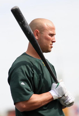TEMPE, AZ - MARCH 08:  Matt Holliday #5 of the Oakland Athletics warms up before the spring training game against the Cleveland Indians at Phoenix Municipal Stadium on March 8, 2009 in Tempe, Arizona. The A's defeated the Indians 8-5.  (Photo by Christian