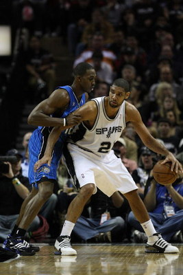 SAN ANTONIO - JANUARY 11: Tim Duncan #21 of the San Antonio Spurs during play against Dwight Howard #12 of the Orlando Magic on January 11, 2009 at AT&T Center in San Antonio, Texas.  NOTE TO USER: User expressly acknowledges and agrees that, by downloadi