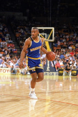 1989:  Tim Hardaway #5 of the Golden State Warriors advances the ball during an NBA game in the 1989-90 season. NOTE TO USER: User expressly acknowledges and agrees that, by downloading and/or using this Photograph, User is consenting to the terms and con