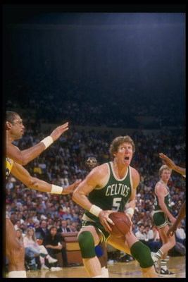 Undated:  Bill Walton of the Boston Celtics prepares to go up strong past center Kareem Abdul-Jabbar of the Los Angeles Lakers during the Celtics game versus the Lakers at the Forum in Inglewood, California. Mandatory Credit: Rick Stewart  /Allsport