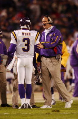 07 Jan 2002 : Head coach Mike Tice of the Minnesota Vikings  advises quarterback Spergon Wynn #3 during the game against the Baltimore Ravens at PSINet Stadium in Baltimore, Maryland. The Ravens won 19-3. DIGITAL IMAGE. Mandatory Credit: Doug Pensinger/Ge