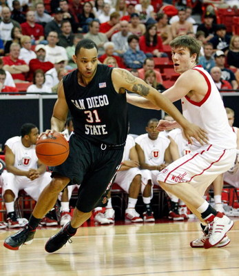 LAS VEGAS - MARCH 14:  Lorrenzo Wade #31 of the San Diego State Aztecs drives around Luka Drca #5 of the Utah Utes during the championship game of the Conoco Mountain West Conference tournament at the Thomas & Mack Center March 14, 2009 in Las Vegas, Neva