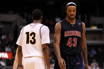 LOS ANGELES, CA - MARCH 12:  Forward Jordan Hill #43 of the Arizona Wildcats walks past guard James Harden #13 of the Arizona State Sun Devils during the final moments of their 68-56 loss to the Sun Devils during the Pacific Life Pac-10 Men's Basketball T