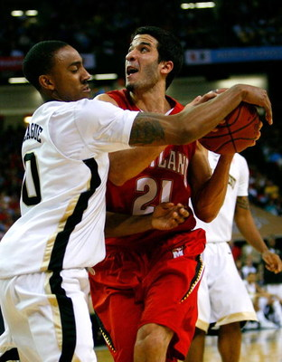 ATLANTA - MARCH 13:  Ishmael Smith #10 of the Wake Forest Demon Deacons reaches in for a steal against Greivis Vasquez #21 of the Maryland Terrapins during day two of the 2009 ACC Men's Basketball Tournament on March 13, 2009 at the Georgia Dome in Atlant