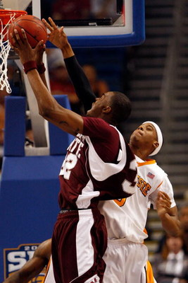 TAMPA, FL - MARCH 15:  Jarvis Varnado #32 of the Mississippi State Bulldogs makes a shot over Renaldo Woolridge #0 of the Tennessee Volunteers during the Championship game of the SEC Men's Basketball Tournament on March 15, 2009 at The St. Pete Times Foru