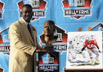 CANTON, OH - AUGUST 2: Andre Tippett of the New England Patriots poses with his bust after his induction during the Class of 2008 Pro Football Hall of Fame Enshrinement Ceremony at Fawcett Stadium on August 2, 2008 in Canton, Ohio.   (Photo by Al Messersc