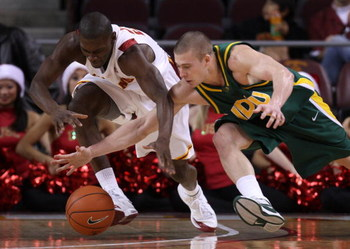 LOS ANGELES, CA - DECEMBER 20:  Marcus Simmons #20 of the USC Trojans and Ben Woodside #10 of the North Dakota State Bison dive for the ball during the first half at the Galen Center on December 20, 2008 in Los Angeles, California. USC defeated North Dako