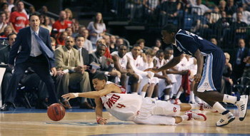 TAMPA, FL - MARCH 23:  A.J. Slaughter #4 of the Western Kentucky Hilltoppers and Clinton Houston #33 of the San Diego Toreros fight for a loose ball in the second round of the 2008 NCAA Tournament West Regional at the St. Pete Times Forum on March 23, 200