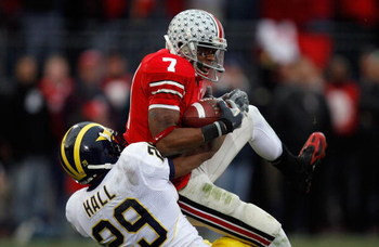 COLUMBUS, OH - NOVEMBER 18:  Ted Ginn Jr. of the Ohio State Buckeyes makes a reception for a 39-yard touchdown in the second quarter against Leon Hall #29 of the Michigan Wolverines November 18, 2006 at Ohio Stadium in Columbus, Ohio. The touchdown gave t
