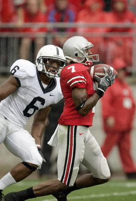 COLUMBUS, 0H - SEPTEMBER 23: Ted Ginn Jr. #7 of Ohio State Buckeyes carries the ball against Donnie Johnson #6 of the Penn State Nittany Lions on September 23, 2006 at Ohio Stadium in Columbus, Ohio. (Photo By Gregory Shamus/Getty Images)