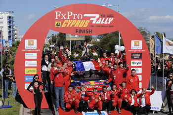 LIMASSOL, CYPRUS - MARCH 15:  Sebastien Loeb of France and Daniel Elena of Monaco with  the complete Citroen World Rally Team in the final cerimonial  of the WRC FxPro Rally of Cyprus 2009 on March 15, 2009 in Limassol, Cyprus.  (Photo by Massimo Bettiol/
