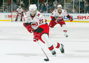 UNIONDALE, NY - OCTOBER 27: Erik Cole #26 of the Carolina Hurricanes skates against the New York Islanders during their game at Nassau Coliseum October 27, 2007 in Uniondale, New York. (Photo by Jim McIsaac/Getty Images)